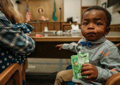 boy watching around courtroom