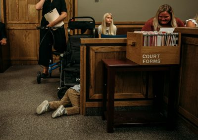 boy crawling in courtroom
