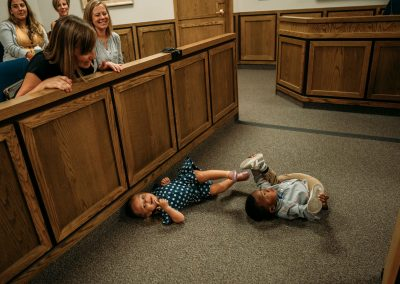kids rolling around court floor