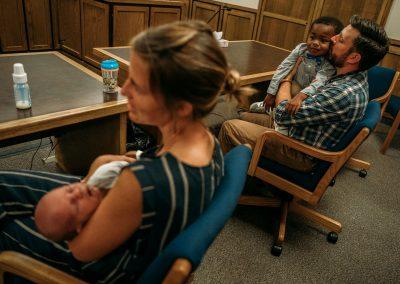 family listening to adoption proceeding