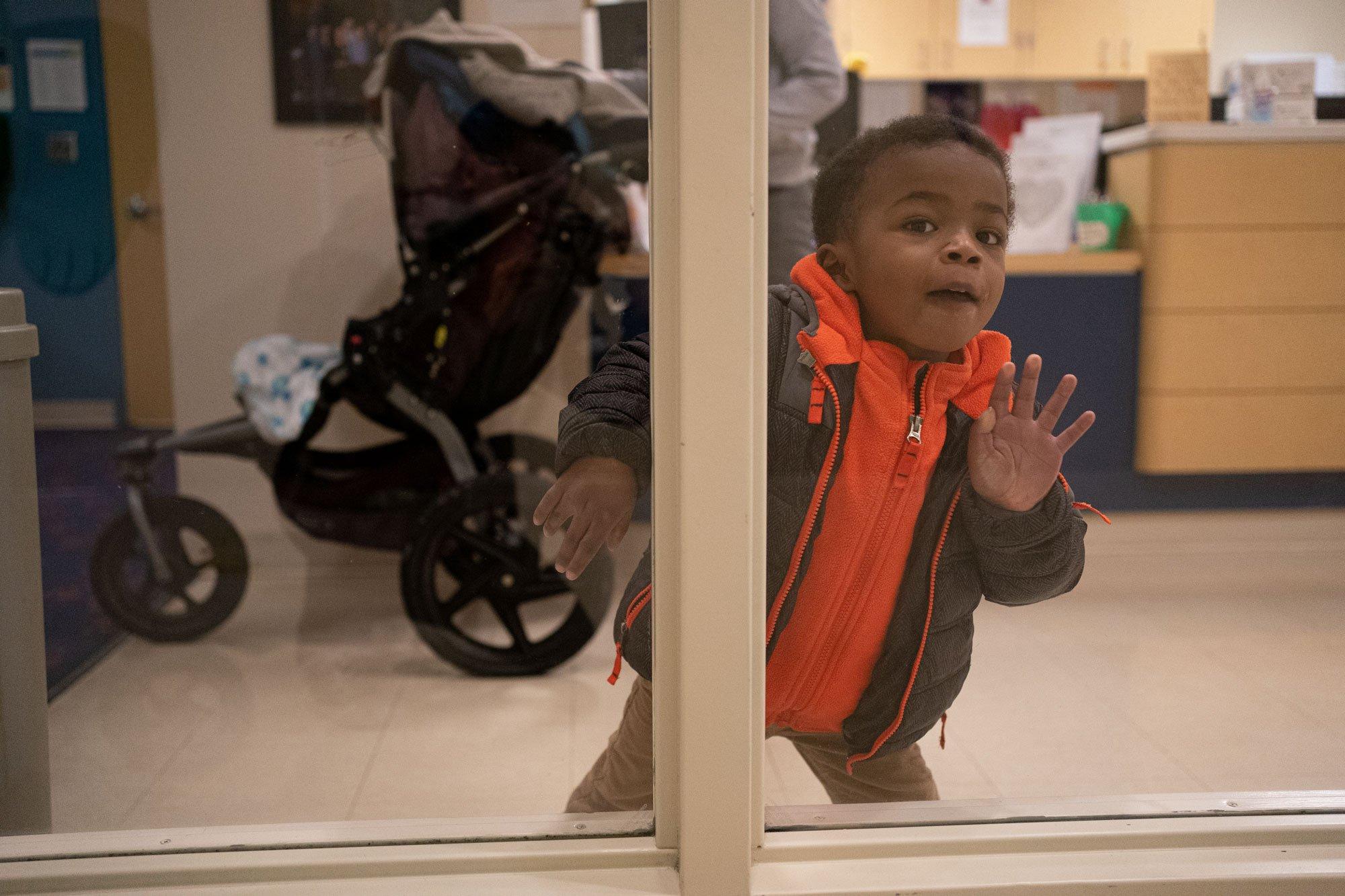 boy peeking out waiting room