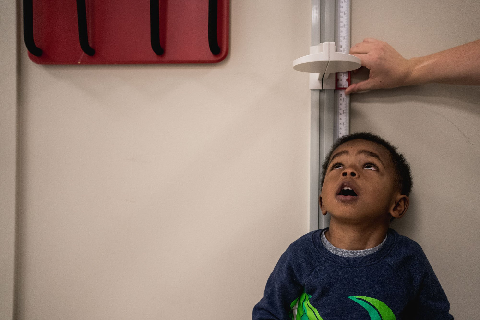 boy watches height measurement
