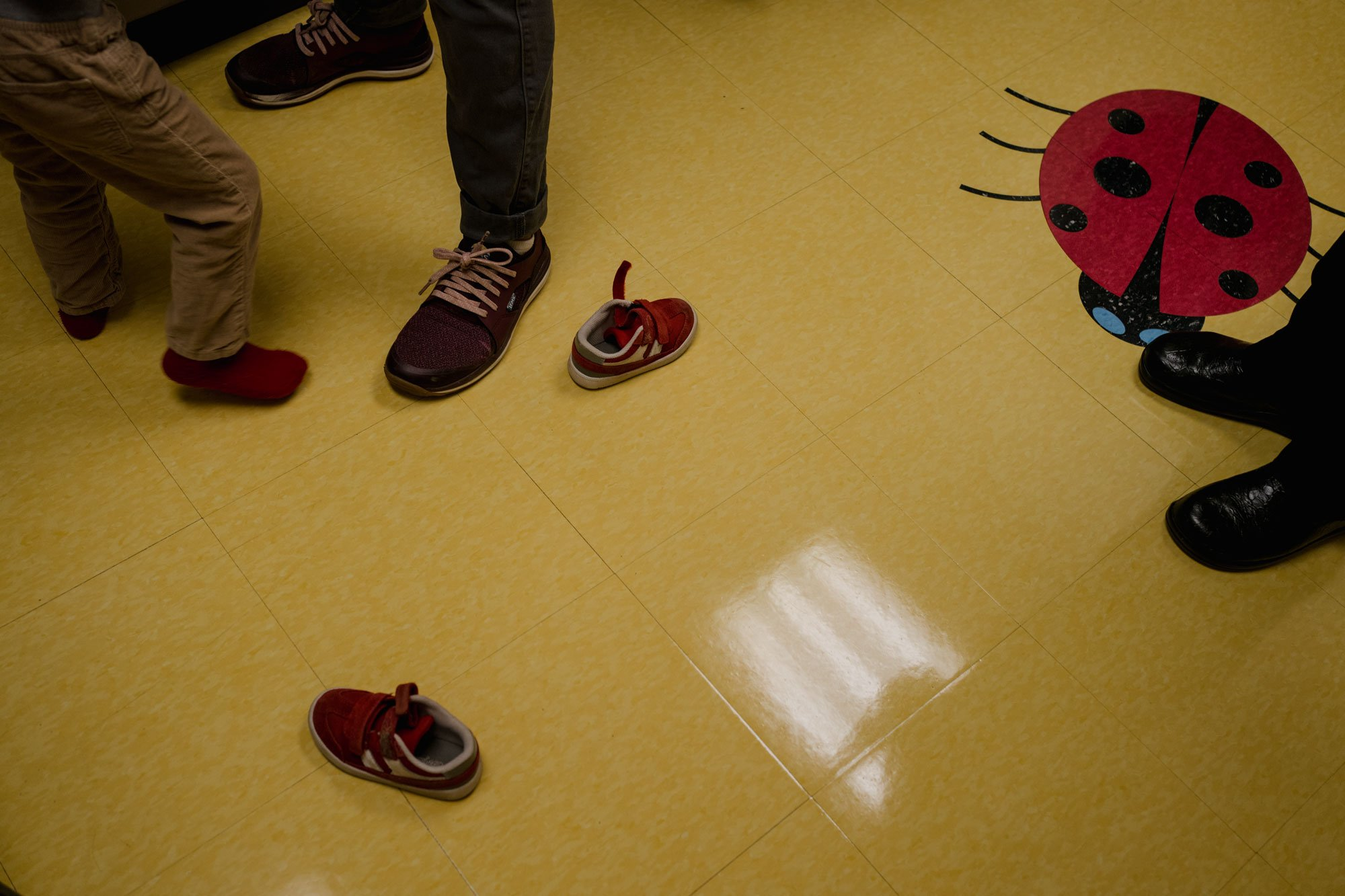 shoes on ground while boy gets ready for exam